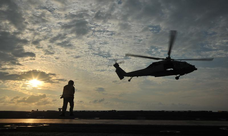 "PACIFIC OCEAN (June 23, 2013) Chief Aviation Boatswain's Mate (Handling) Jonard Sygaco, from Olongapo City, Republic of the Philippines, monitors the departure of an MH-60S Sea Hawk helicopter from the ""Sea Knights"" of Helicopter Sea Combat Squadron (HSC) 25 from the flight deck of the U.S. Navy's forward-deployed aircraft carrier USS George Washington (CVN 73). U.S. Navy photo by Mass Communication Specialist 3rd Class Ricardo R. Guzman"