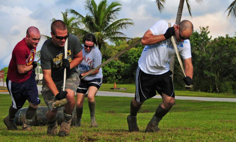 ANDERSEN AIR FORCE BASE, Guam – Airmen from the 36th Munitions Squadron work together to pull a 750 pound inert bomb during the Ammo Olympics here, Aug. 30. The Ammo Olympics is an annual event where the Airmen of 36th Munitions Squadron build teams and compete with each other in events that test the Airmen's strength, teamwork and ingenuity. (U.S. Air Force photo by Airman 1st Class Marianique Santos
