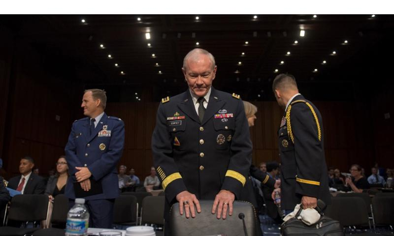 Chairman of the Joint Chiefs of Staff General Martin E. Dempsey waits to be seated during the Senate Armed Services Committee reconfirmation hearing in the U.S. Senate Hart Building in Washington D.C., Thursday, 18, July 2013. Dempsey has been serving as CJCS since October 2001 and has been nominated for a second two-year term. OFFICE OF THE CHAIRMAN OF THE JOINT CHIEFS OF STAFF