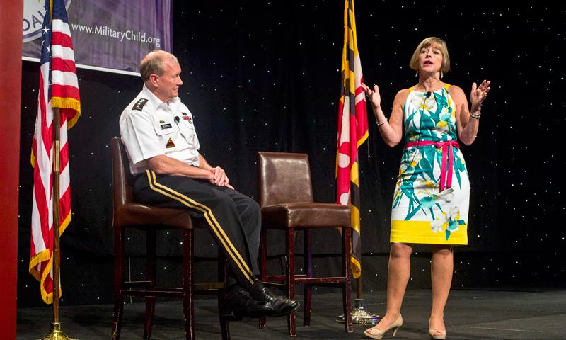 Army Gen. Martin E. Dempsey, chairman of the Joint Chiefs of Staff, and his wife, Deanie, speak at the kickoff of the Military Child Education Coalition's 15th National Training Seminar in National Harbor, Md., July 8, 2013. The coalition works with leading national experts in child development, education and health to support military children. DOD photo by U.S. Navy Petty Officer 1st Class Daniel Hinton
