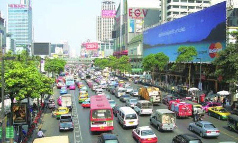 Bangkok's streets bustle with traffic on shopping-intensive routes near Siam Square.