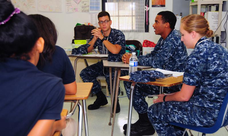 PITI, Guam (April 12, 2013) Hospital Corpsman Kristian Davidson of U.S. Naval Hospital (USNH) Guam, center, discusses his occupation with students during the Seventh Annual Career Day at Jose L. G. Rios Middle School in Piti, Guam, April 12. Sailors from USNH Guam and firefighters from U.S. Naval Base Guam Fire and Emergency Services shared their day-to-day jobs with students to help shape their future career paths. (U.S. Navy photo by Mass Communication Specialist 2nd Class Jeremy Starr)