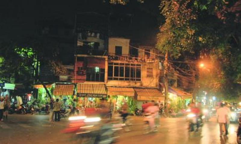Motorbikes on a Hanoi street at night.