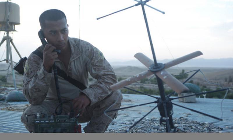 Marine Corps Cpl. Jordi Inoke gets a radio check near the Kajaki Dam in Afghanistan's Helmand province, July 1, 2012. U.S. Marine Corps photo by Cpl. Kenneth Jasik