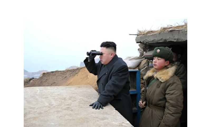 Kim Jong Un uses a pair of binoculars in March 2013 to look at the South's territory from an observation post on North Korea's border with South Korea. To the outside world, the talk often appears to border on the lunatic, but there is logic behind North Korea's bluster, particularly in regard to its domestic audience.   Korean Central News Agency/AP