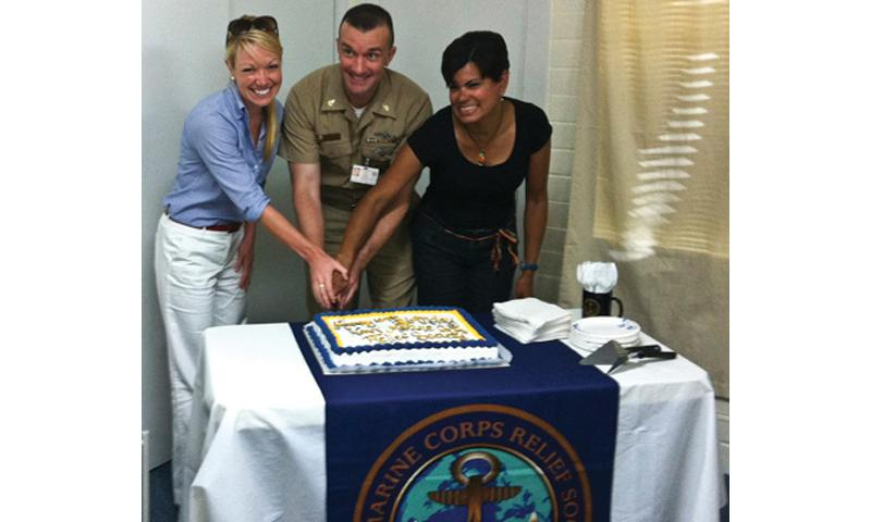 Navy-Marine Corps Relief Society (NMCRS) Client Services Assistant Chair Bre Beach, left, U.S. Naval Base Guam (NBG) Command Master Chief (SW/AW/SCW) John Lawry and NMCRS Thrift Store Chair Lizbeth Lawry cut a cake in celebration of the NMCRS' 109th year in service during a birthday celebration on NBG Jan. 23. The society provides support for service members and their families in nearly 250 offices ashore and afloat. This photo has been altered for security purposes. Photo courtesy of the NMCRS Guam