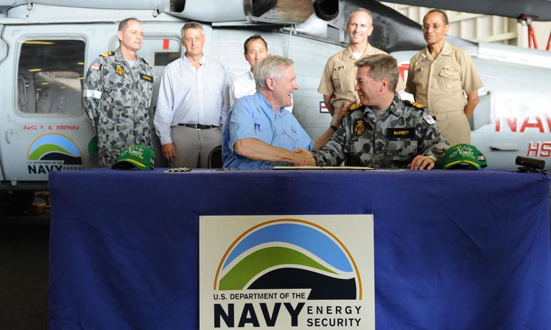 Secretary of the Navy (SECNAV) the Honorable Ray Mabus and Rear Adm. Tim Barrett, commander of the Australian Fleet, shake hands after signing an energy efficiency pact during the Great Green Fleet demonstration portion of the Rim of the Pacific (RIMPAC) 2012 exerciseexercise aboard the aircraft carrier USS Nimitz (CVN 68). (U.S. Navy photo by Mass Communication Specialist 3rd Class Renee Candelario/Released)