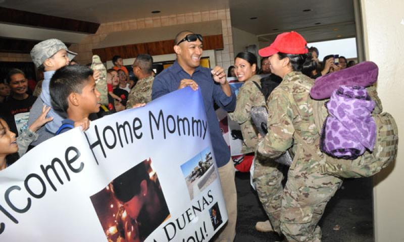 TSgt Kesha Duenas (right) is greeted by family members after she arrived with the 254th RHS from their deployment in Afghanistan.