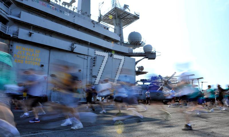 ATLANTIC OCEAN (April 25, 2012) Sailors commence a Sexual Assault Awareness Month (SAAM) 5K run/walk on the flight deck of the Nimitz-class aircraft carrier USS George H.W. Bush (CVN 77). (U.S. Navy photo by Mass Communication Specialist 2nd Class Tony D. Curtis)