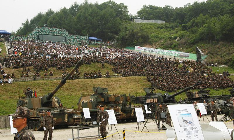 Spectators cover a hillside in South Korea on June 22, 2012, to watch a live-fire drill staged by the militaries of the U.S. and South Korea about 15 miles south of the Demilitarized Zone. A new report lays out how China might respond if North Korea is teetering or collapsing. Jon Rabiroff/Stars and Stripes