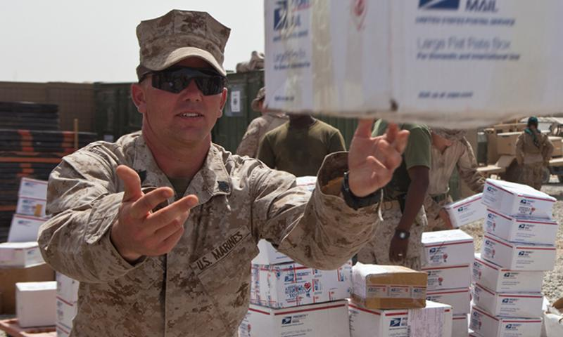 Carrollton, Miss., native Staff Sgt. Louis Nokes, a supply chief with 3rd Battalion, 6th Marine Regiment, tosses a care package to a nearby Marine. Photo by Cpl. Jeff Drew