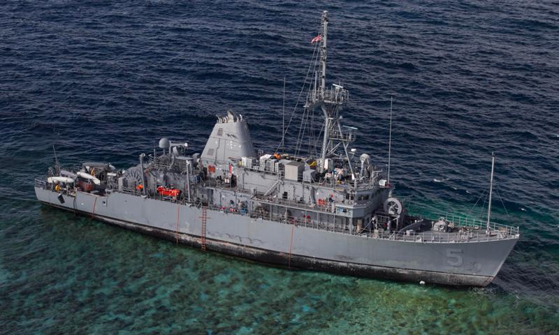 The mine countermeasures ship USS Guardian (MCM 5) sits aground on the Tubbataha Reef.  (U.S. Navy photo by Naval Aircrewman (Tactical Helicopter) 3rd Class Geoffrey Trudell)