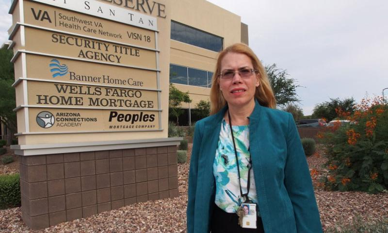 Dr. Katherine Mitchell, a whistleblower who helped uncover a nationwide scandal in veterans' health care, outside her Phoenix VA workplace. Mitchell developed a guide to academic accommodations for disabled veterans after her VA bosses exiled her to an empty clinic in retaliation for reporting patient care problems.  Heath Druzin/Stars and Stripes