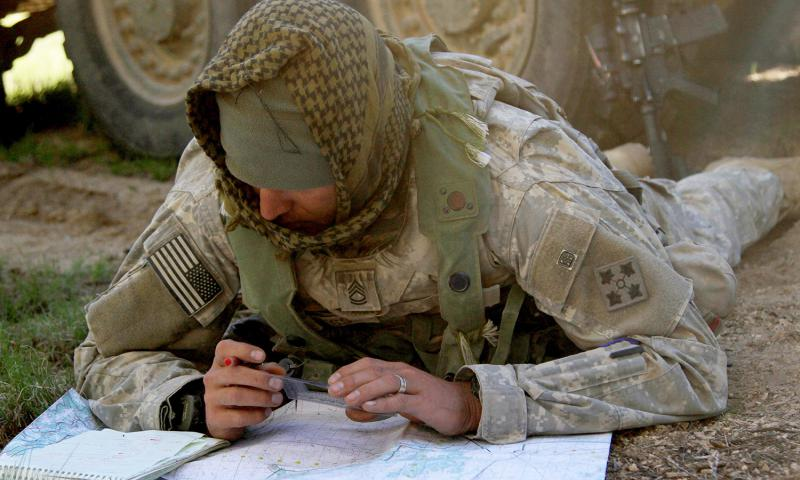 A soldier marks target reference points on a map during a reconnaissance mission as the opposing force in a two day defense phase of the Operation Raider Focus training exercise at Fort Carson's Piñon Canyon Maneuver Site in Colorado, June 7, 2015. U.S. ARMY