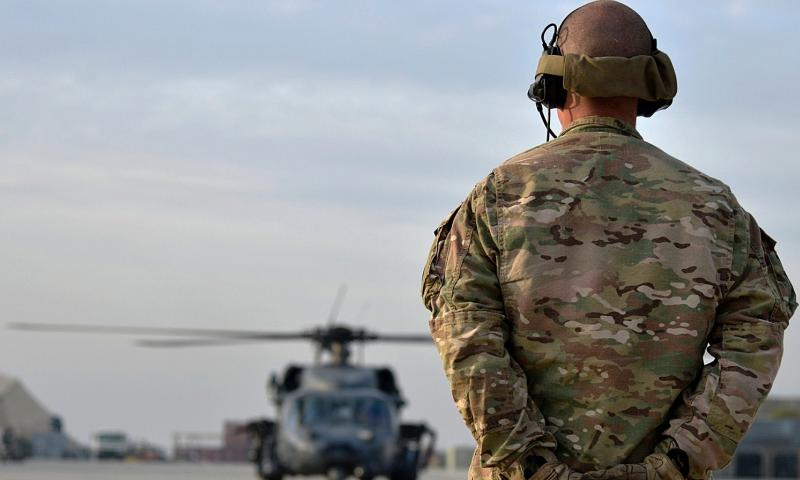 A U.S. Air Force Airman prepares to marshall a HH-60G Pave Hawk at Bagram Air Field, Afghanistan, Nov. 22, 2013. The Air Force is eliminating selective reenlistment bonuses for 46 career fields and cutting retraining opportunities for hundreds of airmen in over-manned specialties as the service prepares to trim the force by as many as 25,000 airmen over the next several years.  Kayla Newman/U.S. Air Force