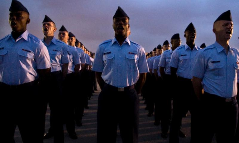A group of 324th Training Squadron basic trainees perform formation and parade drills for their graduation from trainees to Airmen on Lackland Air Force Base, Texas, in this 2009 photo. DESIREE PALACIOS/U.S. AIR FORCE