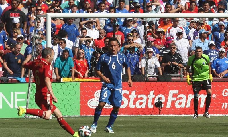 Spain's Andres Inieista cranks off a shot past El Salvador defender Richard Menjivar (6) toward goalkeeperr Henry Hernandez during a pre-World Cup friendly at FedEx Field in Landover, Md., on Saturday, June 7, 2014. Spain won 2-0.   Tom Peterson/MCT