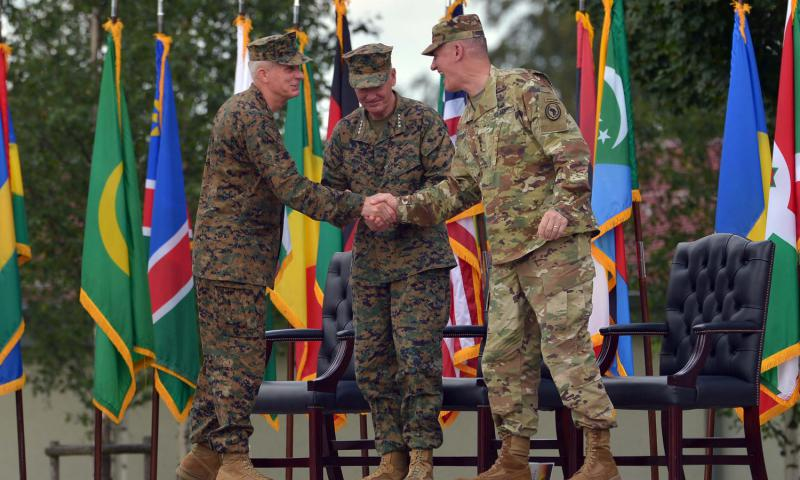 The new commander of U.S. Africa Command, Marine Gen. Thomas D. Waldhauser, left, shakes hands with his predecessor, Army Gen. David M. Rodriguez, as the chairman of the Joint Chiefs of Staff Marine Gen. Joseph F. Dunford looks on. Dunford presided over the change of command at Patch Barracks in Stuttgart, Germany, Monday, July 18, 2016. 	 Michael Abrams/Stars and Stripes