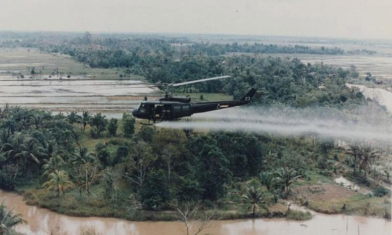 A U.S. military helicopter sprays Agent Orange over Vietnam in this undated photo from the war. Intended to denude the jungle and farmland to deny both cover and food to the Vietcong, American forces sprayed millions of gallons of the defoliant across Vietnam.   U.S. Army