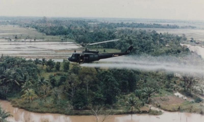 A U.S. military helicopter sprays Agent Orange over Vietnam in this undated photo from the war.   U.S. Army