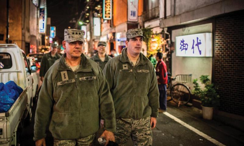 USFJ commander Lt. Gen. Sam Angelella, left, and Col. Mark August, commander of the 374th Airlift Wing, walk through bar row outside Yokota Air Base during a recent courtesy patrol. Samuel Morse/Courtesy U.S. Force