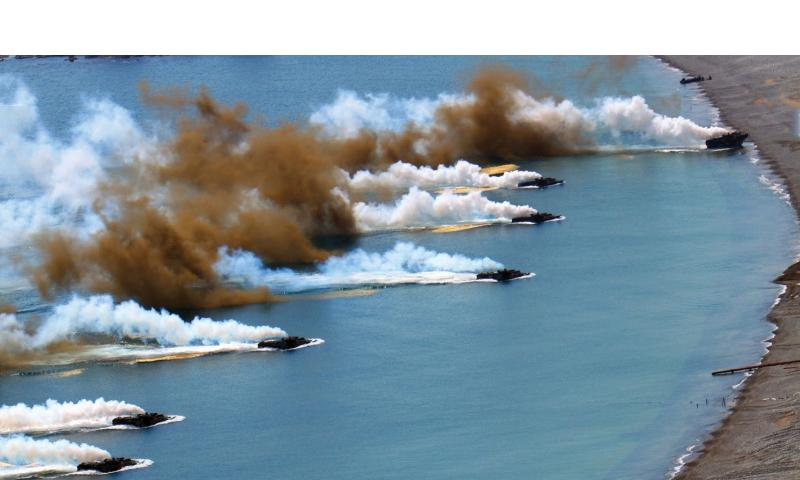 Republic of Korea Marine Corps assault amphibious vehicles advance past a smoke screen as their crews execute an amphibious landing April 26, 2013, at Doksuk-ri Beach, South Korea, during Exercise Ssang Yong 13.  Alyssa N. Gunton/U.S. Marine Corps