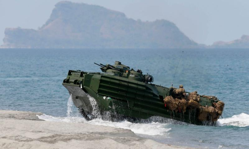In this April 21, 2015 file photo, an amphibious assault vehicle with Philippine and U.S. troops on board storms a beach during an annual U.S.-Philippines joint military drill at the Naval Education and Training Command at San Antonio township, Zambales province, northwest of Manila, Philippines. Amphibious military capabilities are on the agenda the week of May 18, 2015, as the U.S. Marine Corps and Navy host defense leaders from around the Pacific in Hawaii.     Bullit Marquez/AP File photo