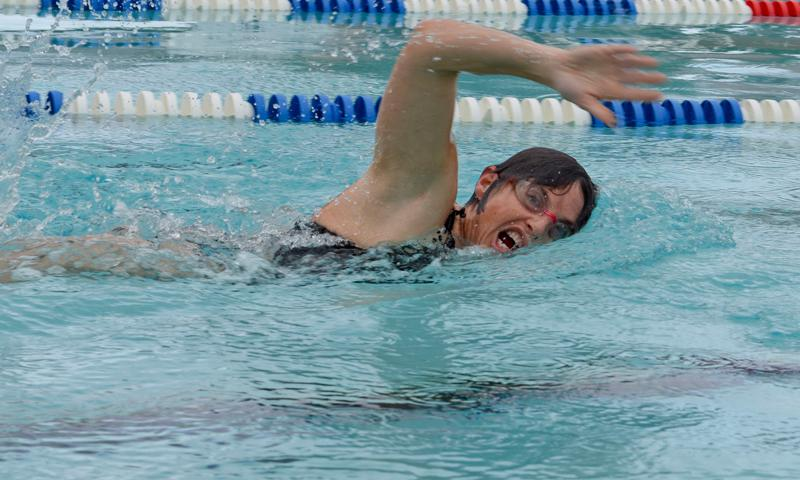 U.S. Air Force Lt. Col. Christine Stabile, 36th Medical Support Squadron commander, swims laps Jan. 9, 2015, at the pool at Andersen Air Force Base, Guam. Stabile has earned 14 straight 100s since 2004, when the Air Force changed the physical fitness test. (U.S. Air Force photo by Staff Sgt. Robert Hicks)