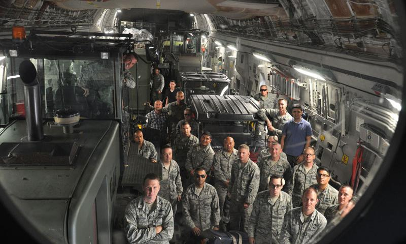 Members of the 36th Contingency Response group board a C-17 Globemaster III destined for Kathmandu, Nepal, at Andersen Air Force Base, Guam, May 4, 2015. The CRG will join U.S. Department of State and U.S. Agency for International Development led humanitarian and disaster relief operations in support of the government and armed forces of Nepal. (U.S. Air Force photo by Maj. Ashley Conner)