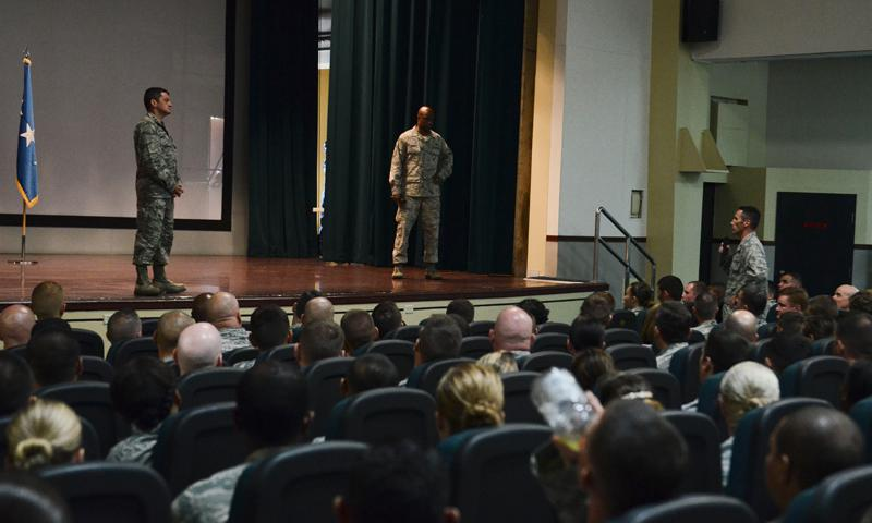 (Right) Lt. Col. Steve Harrold, 36th Operations Group deputy commander, asks Lt. Gen. Russell Handy, 11th Air Force commander, a question during an all call June 19, 2014, on Andersen Air Force Base, Guam. Handy took the opportunity to address Andersen's Airmen following the 36th Wing change of command. (U.S. Air Force photo by Airman 1st Class Emily A. Bradley)