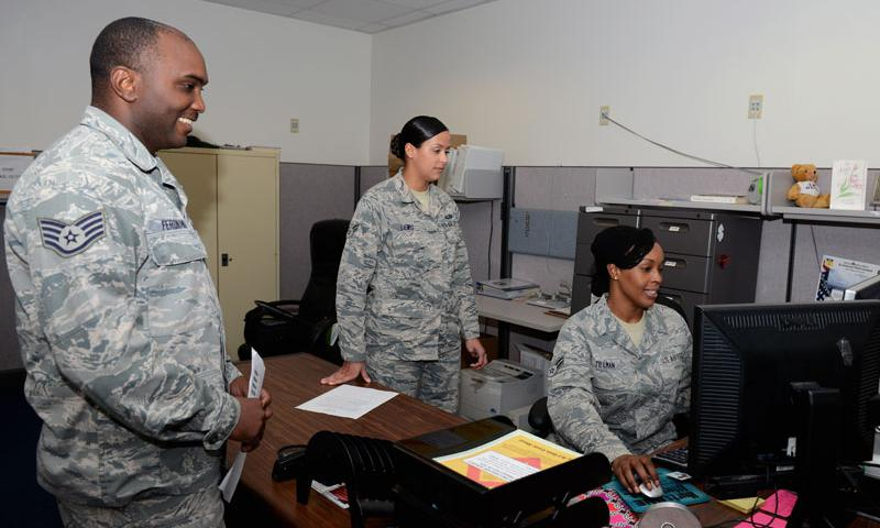 Airman 1st Class Vanessa Lewis and Airman 1st Class Aisha Tillman, 36th Force Support Squadron technicians, assist Staff Sgt. Robinson Ferdinand, 36th Civil Engineer Squadron, with updating his records Sept. 9, 2015, at Andersen Air Force Base, Guam. The awards and decorations office ensures achievements are rightfully given to service members and updates their records for career progression. (U.S. Air Force photo by Airman 1st Class Arielle Vasquez)