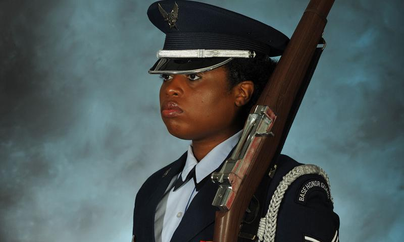 Senior Airman Ameka Mmoh, 36th Wing Public Affairs broadcast journalist, poses stands for a photo in her Air Force ceremonial uniform with her rifle Feb. 11, 2016, at Andersen Air Force Base, Guam. In addition to being a Guardsman, Mmoh schedules and coordinates details and ceremony requests for Andersen Air Force Base's Honor Guard. (U.S. Air Force Photo/Airman 1st Class Jacob Skovo)