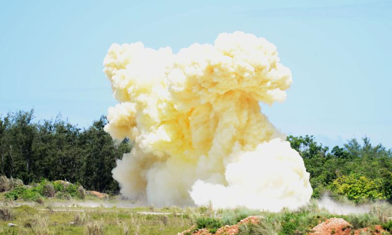 Smoke rises after several 15-pound demolition charges are detonated by Aug. 12, 2015, at Andersen Air Force Base, Guam. 554th RED HORSE Squadron explosive demolition team members are tasked with discharging explosives to deny base access or blasting rock quarries for raw construction material. (U.S. Air Force photo by Senior Airman Joshua Smoot)