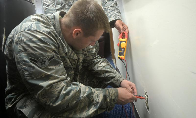 Airman Dakota Bennett, 36th Civil Engineer Squadron electrical systems specialist, tests the voltage of a wall socket Aug. 5, 2015, at Andersen Air Force Base, Guam. Composed of 22 military members and 10 civilians, the unit works in unison to ensure the base has power as well as performing preventative maintenance daily. (U.S. Air Force photo by Senior Airman Joshua Smoot)