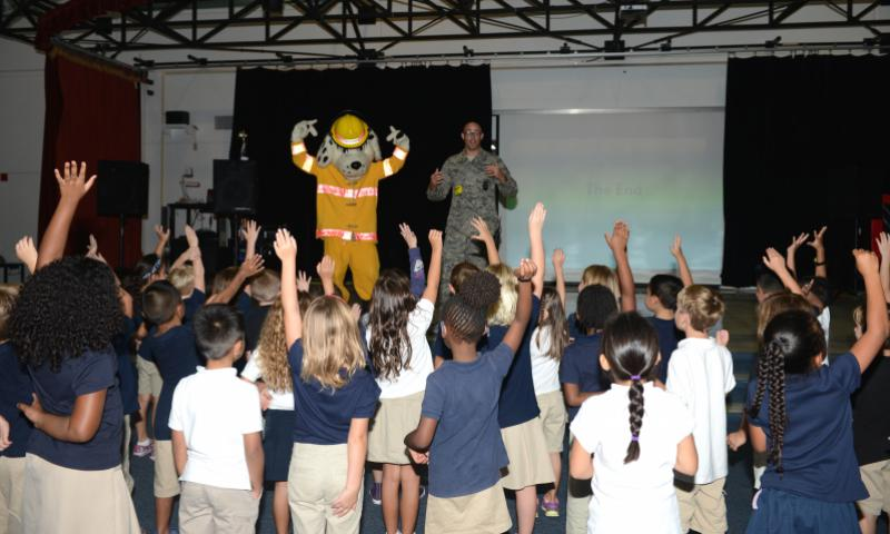 Sparky the Fire Dog visits Andersen Elementary School students Oct. 6, 2015, at Andersen Air Force Base, Guam. The firefighters demonstrated the importance of fire safety to the students in observance of Fire Prevention Week. (U.S. Air Force photo by Airman 1st Class Arielle Vasquez)