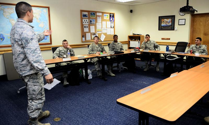 Airman 1st Class Enrique Flores, 36th Civil Engineer Squadron electrical systems apprentice, practices his speaking skills while attending a class at the first term Airmen center Jan. 9, 2014, on Andersen Air Force Base, Guam. FTAC is a program that facilitates representatives from different base units who help Airmen get started on their careers and to learn the tools necessary to become successful. (U.S. Air Force photo by Airman 1st Class Amanda Morris)