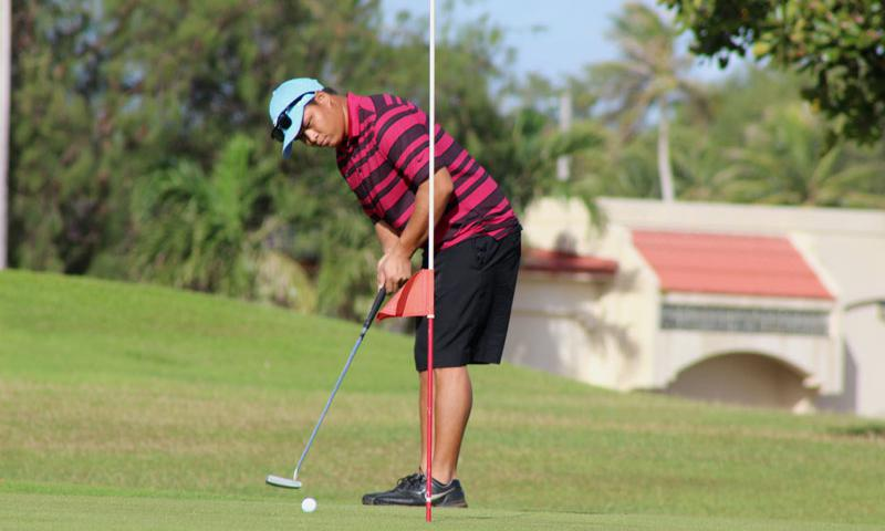 A Team Andersen golfer focuses on his put Jan. 31, 2015, during a tournament on Andersen Air Force Base, Guam. The Palm Tree Golf Course was renovated at the beginning of 2015, moving the pro shop to the actual golf course and renumbering the holes among other changes to improve Airman morale and quality of life. (U.S. Air Force photo by 1st Lt. Jessica Clark)