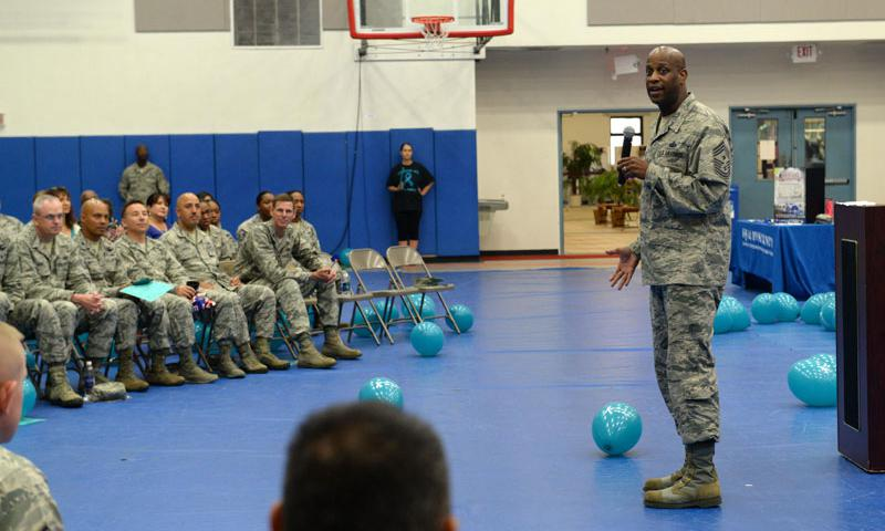 Chief Master Sgt. Michael McMillan, 36th Wing command chief, speaks about sexual assault prevention and response during an awareness rally April 1, 2015, at Andersen Air Force Base, Guam. April is recognized as Sexual Assault and Awareness Prevention month, which is dedicated to raising awareness and educating Airmen and their families about prevention methods. (U.S. Air Force photo/Airman 1st Class Alexa Ann Henderson)
