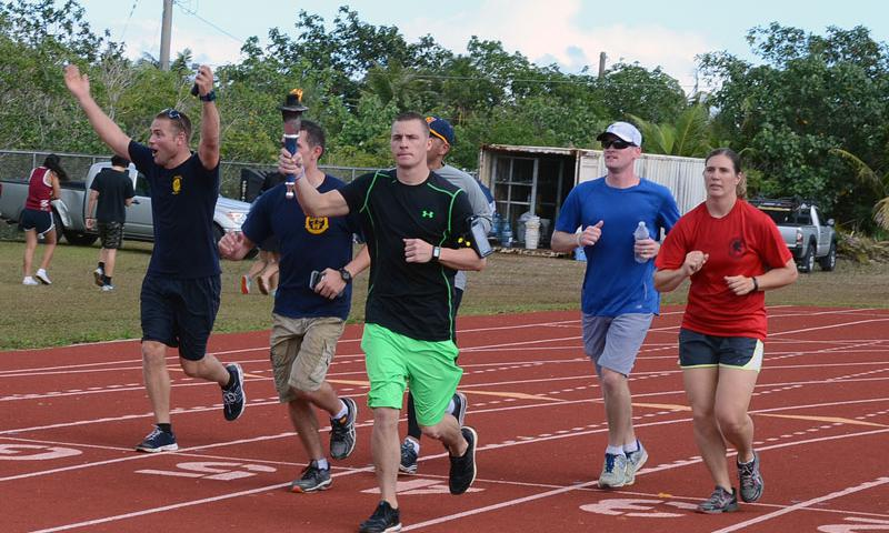 Staff Sgt. Eric Mattson, 554th RED HORSE Squadron, carries the Special Olympics Flame of Hope Torch at Okkodo High School in Dededo, Guam, March 21, 2015. More than 300 service members from all military branches assigned to units on Guam came together to support Special Olympic athletes in a variety of track and field events. (U.S. Air Force photo by Airman 1st Class Alexa Ann Henderson)