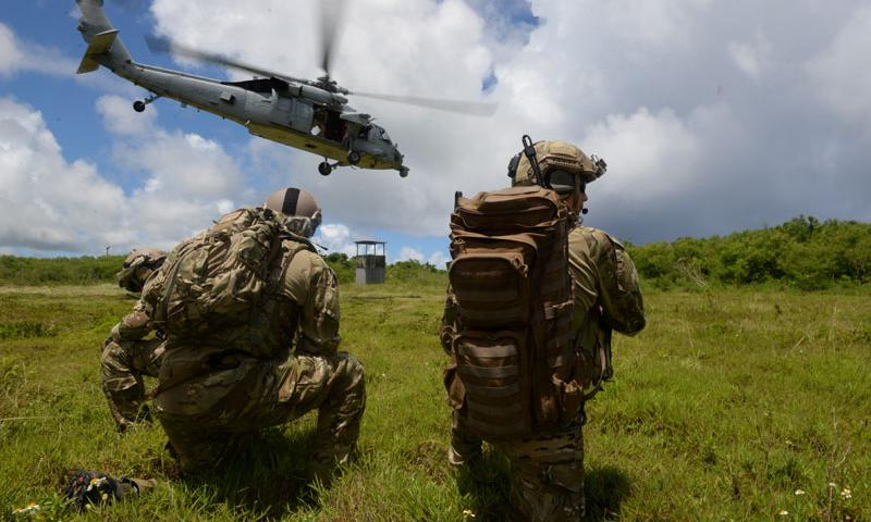 Tactical Air Control Party Airmen with the 3rd Air Support Operations Squadron from Joint Base Elmendorf-Richardson, Alaska, watch as a MH-60S Seahawk takes off July 22, 2015, at Andersen Air Force Base South, Guam. The joint terminal attack controller team conducted essential close air support training. (U.S. Air Force photo by Staff Sgt. Alexander W. Riedel)