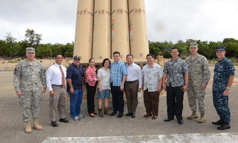 ANDERSEN AIR FORCE BASE, Guam (May 7, 2014) - Senators of the 32nd Guam Legislature pose with military leadership in front of the Terminal High-Altitude Area Defense (THAAD) system on Andersen Air Force Base May 7. The senators visited the site to gain a deeper understanding of the THAAD mission, which has been at Andersen since April 2013. (U.S. Air Force photo by Airman 1st Class Adarius Petty)