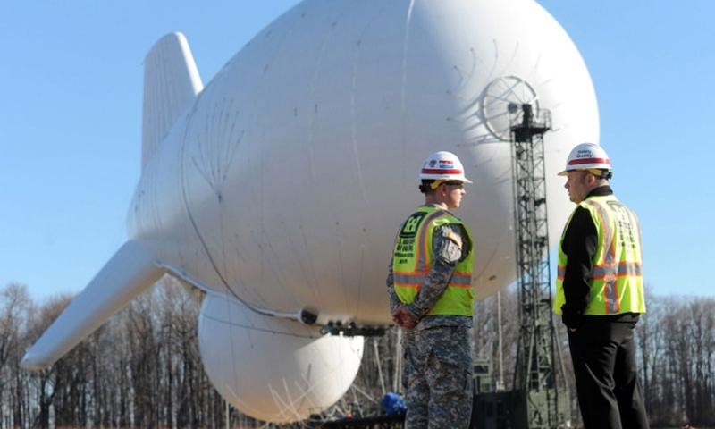 In a December, 2014 file photo, Army Capt. Dave MacPhail, left, and Jeff Crosse, project manager for the United States Army Corps of Engineers, talk on the site where one of the JLENS (Joint Land Attack Cruise Missile Defense Elevated Netted Sensor System) blimps is tethered at Aberdeen Proving Ground.  Kim Hairston, Baltimore Sun/TNS