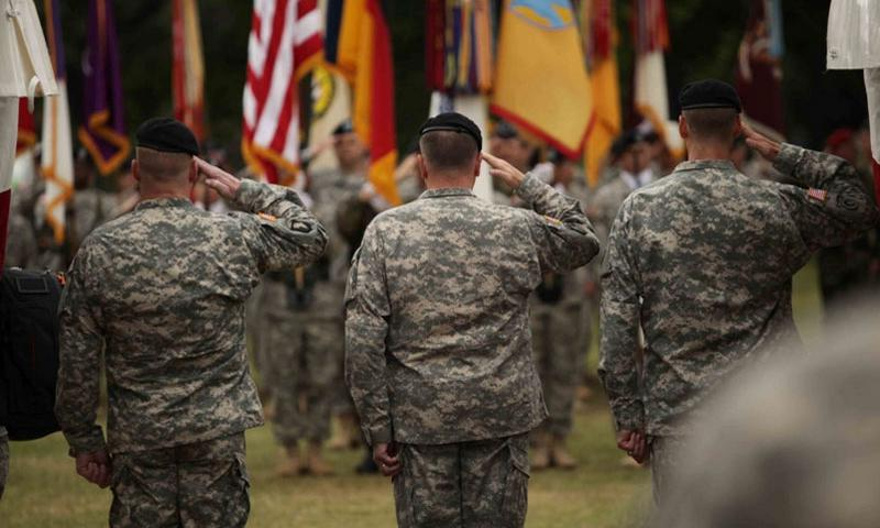Maj. Gen. Duane A. Gamble the incoming commander of the 21st Theater Sustainment Command, U.S. Army Europe commander Lt. Gen. Ben Hodges, and outgoing 21st commander Maj. Gen. John R. O'Connor, salute the American flag during the playing of the national anthem at the TSC's change of command ceremony Wednesday, June 24, 2015, in Kaiserslautern, Germany. MATT MILLHAM/STARS AND STRIPES