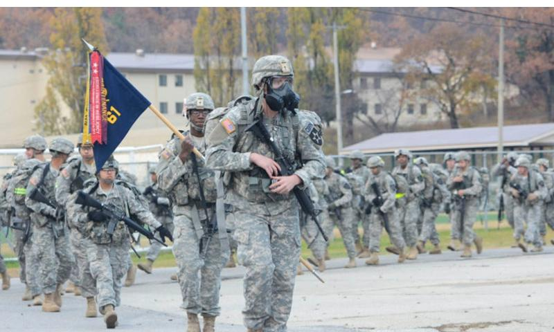 Soldiers from the 1st Armored Brigade Combat Team, 2nd Infantry Division start the Manchu Mile on Nov. 6, 2014, in South Korea. More than 800 soldiers participated in the 25-mile road march.    Jacqueline Dowland/U.S. Army