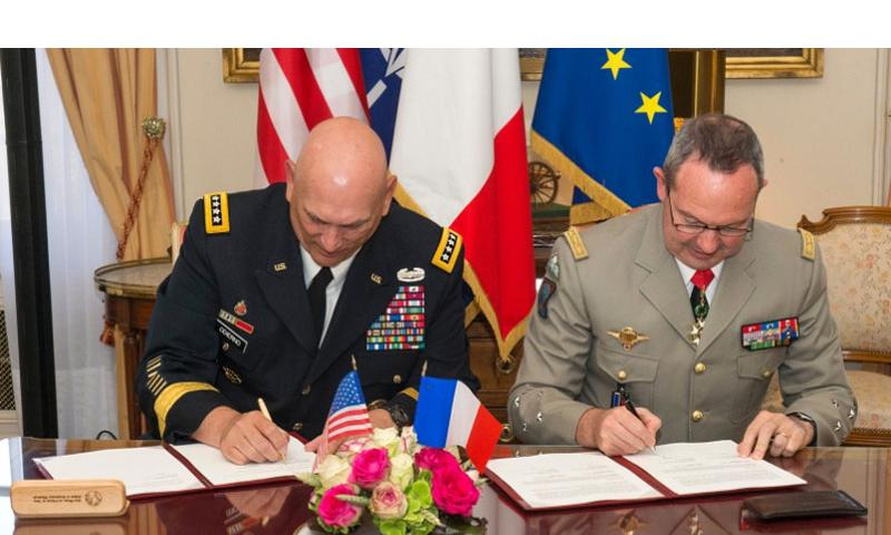 U.S. Army Chief of Staff, Gen. Ray Odierno (left), and France Army Chief of Staff, Gen. Jean-Pierre Bosser sign the French Strategic Vision Statement and Presser in the Hotel des Invalides, Paris, France, on July 10, 2015. Odierno was on a four-day tour of Europe where he visited Soldiers in training, U.S. Army Europe leadership, and dignitaries in four countries.    Chuck Burden/U.S. Army
