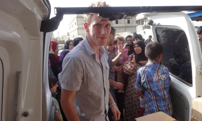 This undated photo provided by the Kassig Family shows Peter Kassig delivering supplies for Syrian refugees. A new graphic video purportedly produced by Islamic State militants in Syria released Sunday Nov. 16, 2014 claims U.S. aid worker Kassig was beheaded.   Courtesy Kassig Family