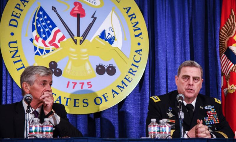 Secretary of the Army John McHugh, left, and Army Chief of Staff Gen. Mark Milley speak at the AUSA convention in Washington, D.C., Oct. 12, 2015.  Corey Dickstein/Stars and Stripes