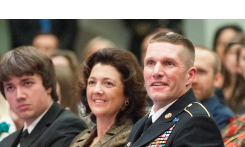 Command Sgt. Maj. Daniel Dailey sits beside his wife, Holly, and son, Dakota, just before being called up to become the 15th Sergeant Major of the Army during a swearing-in ceremony at the Pentagon in Arlington, Va., on Jan. 30, 2015.     Carlos Bongioanni/Stars and Stripes