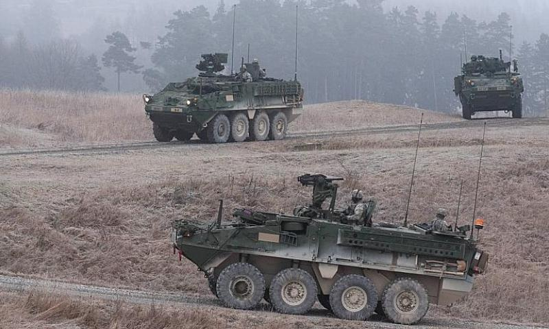 Stryker armored combat vehicles patrol USAG Bavaria's new convoy live-fire course during its opening, Dec. 18, 2013. Michael Darnell/Stars and Stripes