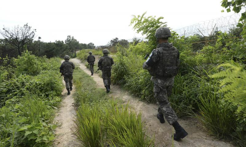 South Korean soldiers patrol inside the Demilitarized Zone near Paju, South Korea, in August 2015 after explosions from land mines laid by North Korea maimed two South Korean soldiers. South Korea's military said it conducted its largest-ever artillery drill near the heavily militarized border with the North on Thursday. Courtesy of South Korean Defense Ministry